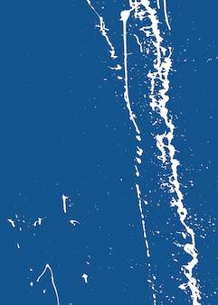 Kreativer abstrakter weißer sprühfarbenspray auf einem blau