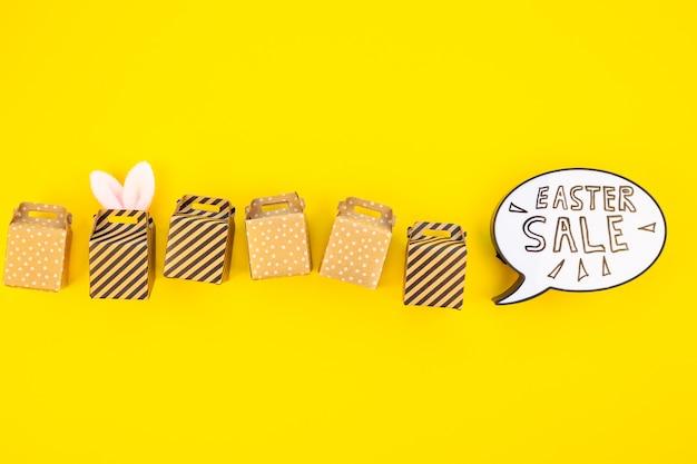 Kreativer draufsichtfeiertag ostern-verkaufs-konzept