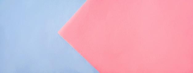 Kreativer farbpapierpastellhintergrund, ansicht von oben.