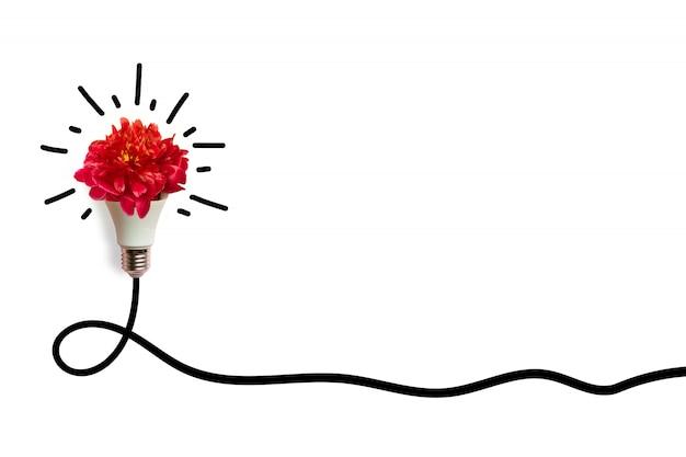Kreatives conceptof eine leuchtende energiesparende glühlampe auf weißem hintergrund. energieeinsparung oder ideenkonzept.