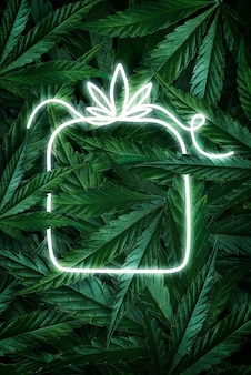 Kreatives fluoreszierendes weihnachtshintergrund-layout aus hanf verlässt marihuana und neonzeichengeschenk