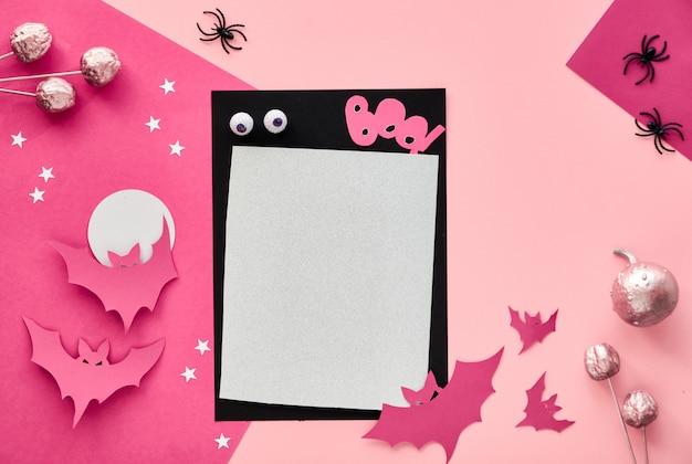 Kreatives papierhandwerk halloween flach lag in rosa und schwarz.