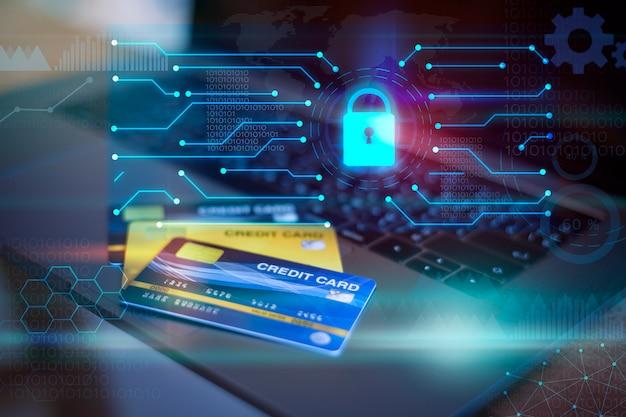 Kreditkarte auf computer mit digitalem vorhängeschloss und technologie-symbolen, kreditkarten-sicherheitskonzept