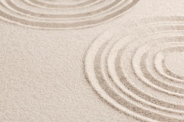 Kreisen sie zen-sandhintergrund im achtsamkeitskonzept ein
