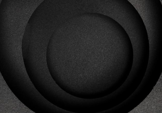 Kreisförmige schichten mit dunklem hintergrund
