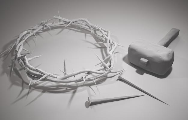 Kreuzigung von jesus christus - kreuz mit hammer nägel und dornenkrone 3d rendering weißen hintergrund