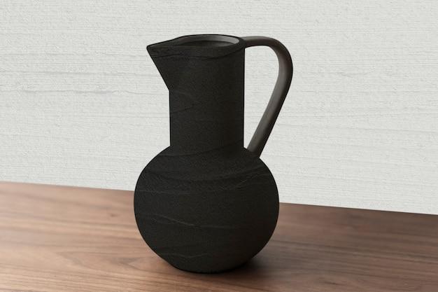 Krugvase aus schwarzer strukturierter keramik auf einem holztisch
