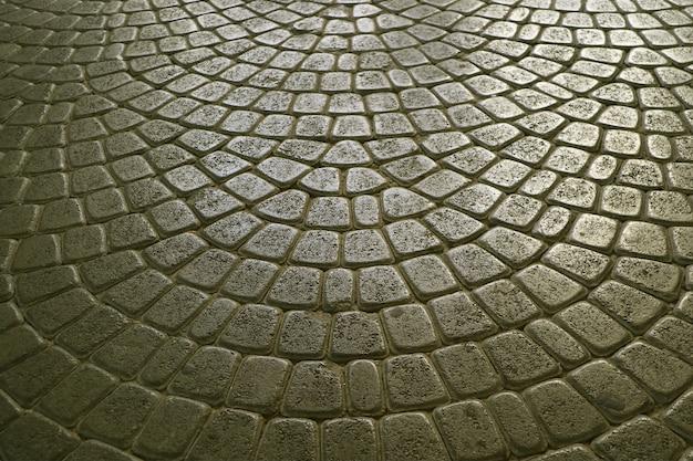Künstlerische steinpflasterung in der altstadt für hintergrund
