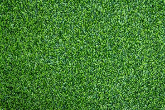 Künstliche beschaffenheit des grünen grases kann gebrauch als hintergrund sein