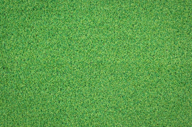 Künstliche grüne grasbeschaffenheit für den hintergrund