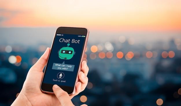 Künstliche intelligenz, ki-chat-bot-konzept. hände, die handy auf unscharfer städtischer stadt halten.