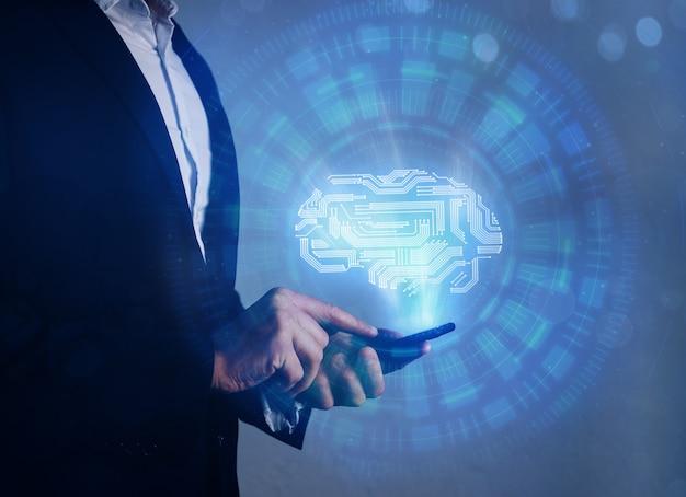 Künstliche intelligenz (ki), maschinelles deep learning, data mining. gehirn mit pcb-design, das smartphone darstellt und geschäftsmann hält.