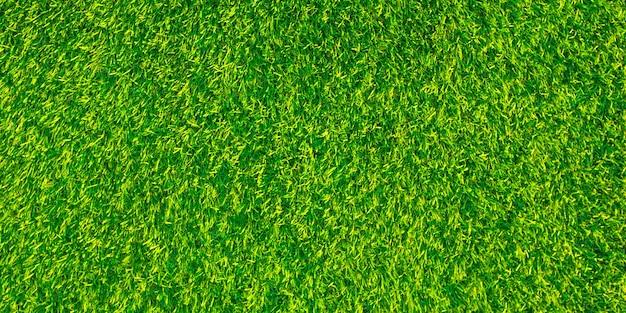 Künstliches grünes gras natürliche künstliche grüne grasbeschaffenheitshintergründe