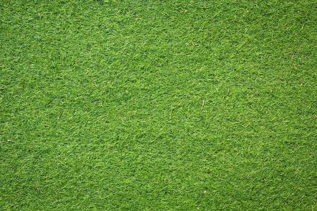 Künstliches grünes gras textur für den hintergrund