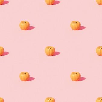 Kürbismuster auf rosa hintergrund für werbung an herbstferien oder verkäufen, 3d-rendering