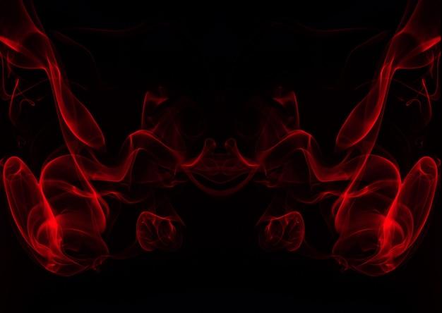 Kunst der roten rauchzusammenfassung auf schwarzem hintergrund, feuer
