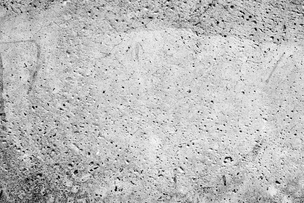 Kunstbeton- oder steinbeschaffenheit für hintergrund in den grauen und weißen farben
