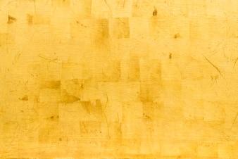 Künstlicher Goldhintergrund und -beschaffenheit auf Zement