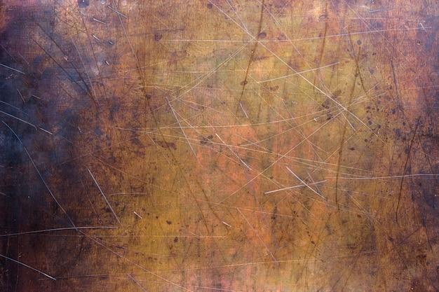 Kupfer- oder messinghintergrund, textur des nichteisenmetalls