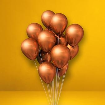 Kupferballonbündel auf einem gelben wandhintergrund. 3d-darstellung rendern