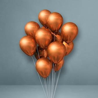 Kupferballonbündel auf einem grauen wandhintergrund. 3d-darstellung rendern