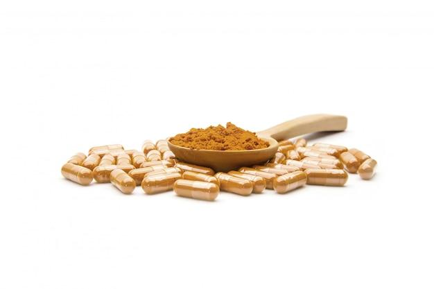 Kurkuma oder curcuma longa kräuterkapsel und pulver isoliert
