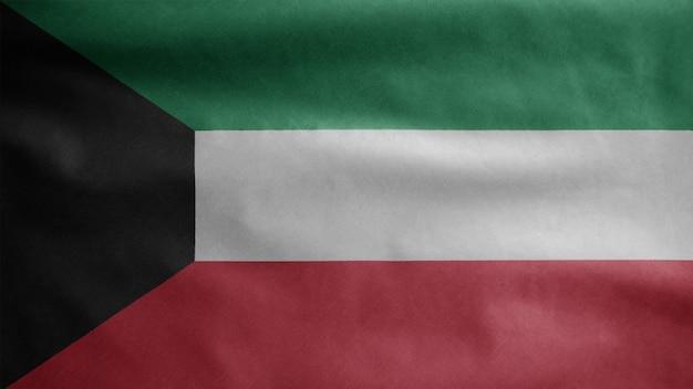 Kuwaitische flagge weht im wind. nahaufnahme von kuwait-banner weht, weiche und glatte seide. stoff textur fähnrich hintergrund. verwenden sie es für das konzept für nationalfeiertage und länderanlässe.