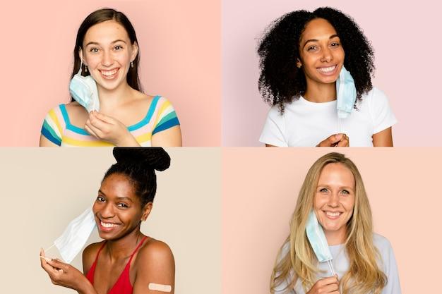 Lächelnde verschiedene frauen, die in der neuen normalität die gesichtsmaske abnehmen