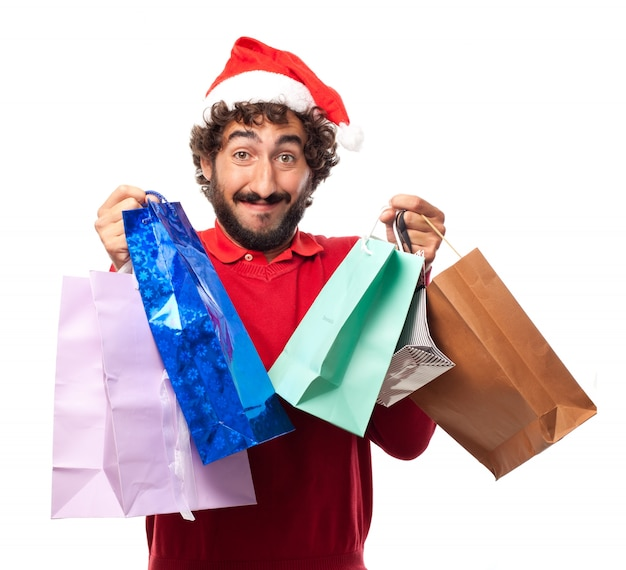 Lächelnder kerl nach einem shopping-tag