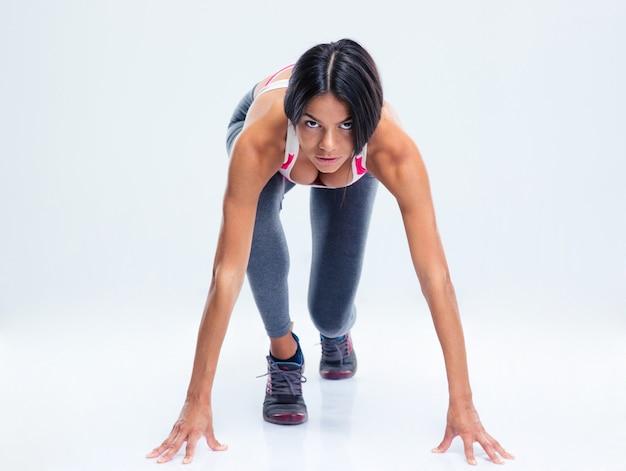 Läufer sportliche frau in startposition