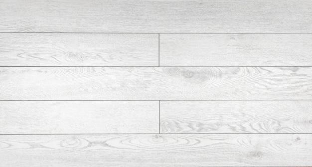 Laminat hintergrund. hölzerne laminat- und parkettbretter für den boden in der innenarchitektur. textur und muster aus naturholz