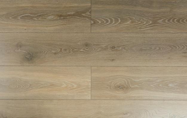Laminathintergrund. holzlaminat und parkett für den boden in der innenausstattung. textur und muster aus naturholz