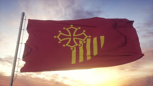 Languedoc-roussillon-flagge, frankreich, weht im wind-, himmels- und sonnenhintergrund. 3d-rendering
