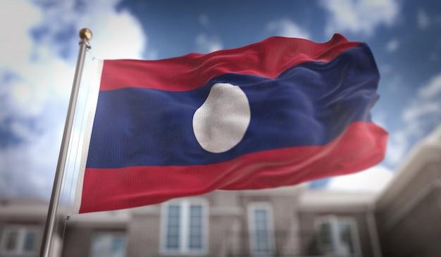 Laos flagge 3d rendering auf blauem himmel gebäude hintergrund