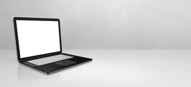 Laptop-computer auf weißem betonbüroszenenhintergrundfahne. 3d-illustration