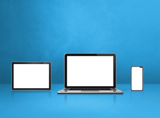 Laptop, handy und digitaler tablet-pc auf blauem schreibtisch. 3d-illustration