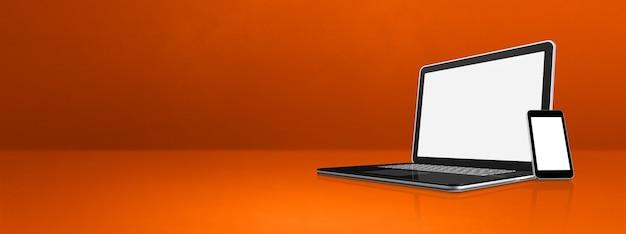 Laptop und handy auf orange büro schreibtisch banner. 3d-illustration