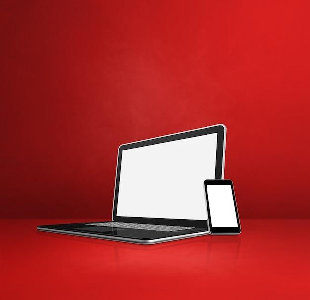 Laptop und handy auf rotem schreibtisch. 3d-illustration