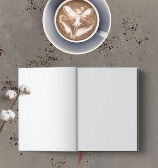 Lattekunst einer fee und ein leeres offenes buch auf grau