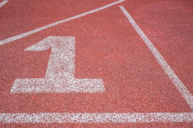 Laufstrecke, sportplatz, nummer eins gewinner-konzept