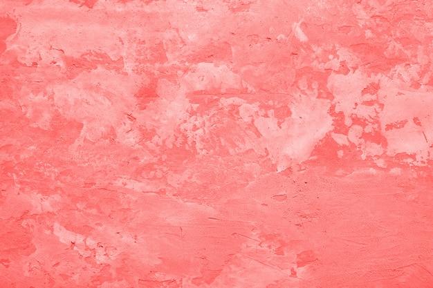Lebende korallenfarbe fleckige textur der betonwand