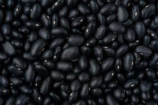 Lebensmittelhintergrund der schwarzen bohnen. ansicht von oben, oben.