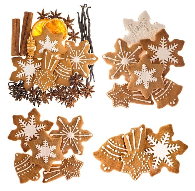 Lebkuchenplätzchen und gewürze lokalisiert auf weißem hintergrund. süßes weihnachtsessen. zimtstangen, sternanis, vanille und nelken