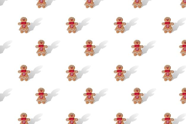 Lebkuchenweihnachtsmann auf weißem hintergrundwiederholungsmuster