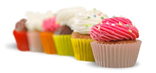Leckere bunte cupcakes im hintergrund