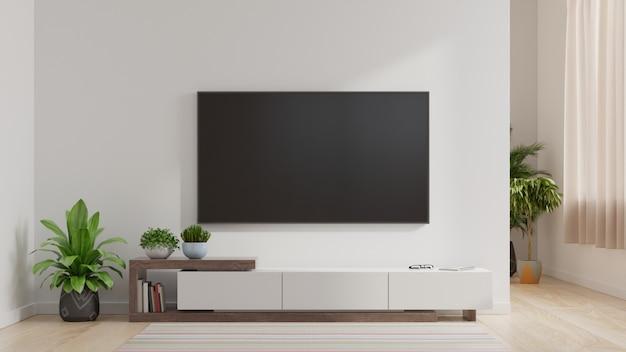 Led-fernseher an der weißen wand im wohnzimmer, minimales design.