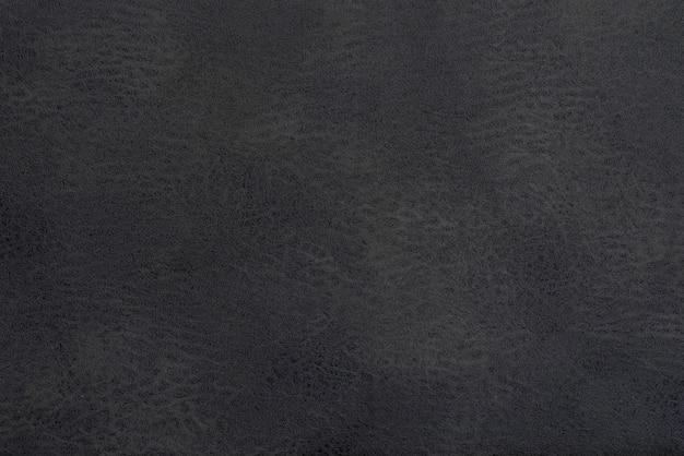 Lederner schwarzer hintergrund und zusammenfassung, detail des grauen ledernen hintergrundes