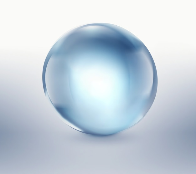 Leere blaue glaskugel auf hellem hintergrund