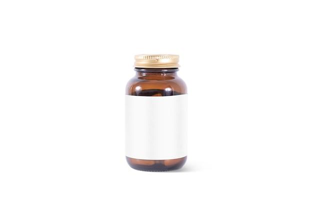 Leere braunglas-pillendose mit weißem etikett, isoliert