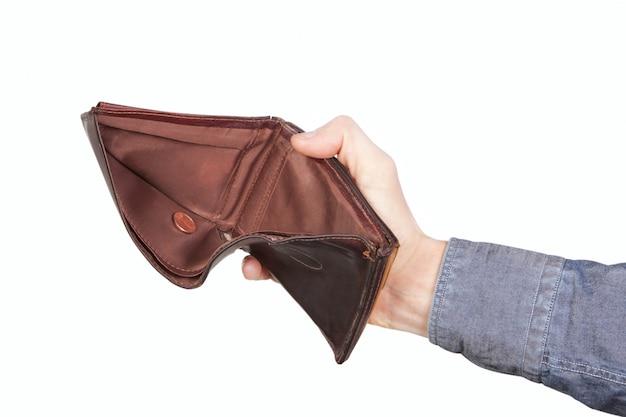 Leere brieftasche und ein centime. an einer weißen wand.